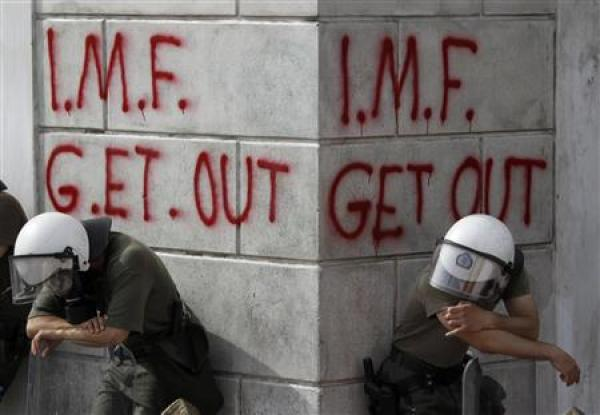 "Graffiti on the wall in Athens says ""I.M.F. GET OUT"""